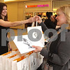 Photo by Frank J. Leone, Jr.  Greeting customers at the store opening, at left, Derika Burke of Windham, with Mary Ann Hutchinson<br /> of Hampstead,<br /> at Lord & Taylor Store Grand Opening, Friday, at Rockingham Mall, Salem, NH.