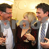 Photo by Frank J. Leone, Jr.   Enjoying the evening, at left, Jim Dederian, Maryann and Karl Dubay, all are from Windham,<br /> Jim's daughter, Amy Lamparelli is the salon's proprietor,<br /> at the Re-Opening of Salon Bogar, Thursday, 25 Orchard View Drive, Londonderry, NH.