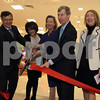 Photo by Frank J. Leone, Jr.   Cutting the ribbon for the new Lord & Taylor store at Rockingham Mall, Salem, NH., from left,<br /> David Contif, president of Simon Properties, Mall owner, Karen Conroy of Portsmouth, store manager, Bonnie Brooks, president of Lord & Taylor<br /> stores and Governor John Lynch of New Hampshire, at<br /> Lord & Taylor Store Grand Opening, Friday, at Rockingham Mall, Salem, NH.<br /> 3/16/12