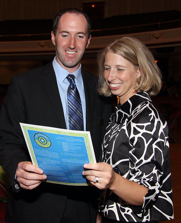 Looking over the evening's program are Craig Mackenzie,<br /> board member of Lowell Five Bank with Allison Lamey, board member, City of<br /> Lowell, both are from Lowell.