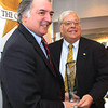 Photo by Frank J. Leone, Jr.  At left, Al DeNapoli of Boston, founder of Family Business Association, presents the<br /> Family Business Advocacy Award to Merrimack Valley Chamber of Commerce CEO, Joseph Bevilacqua of Haverhill,   <br /> at the Merrimack Valley Chamber of Commerce Women in Business Conference, Monday,  DiBurro's Function Hall, Haverhill.