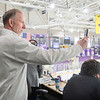 Paul Allan, associate athletic director for Minnesota State, takes video at the start of a hockey game against Alaska Anchorage. Allan is originally from Calgary, Canada but was hired at MSU in 1985.