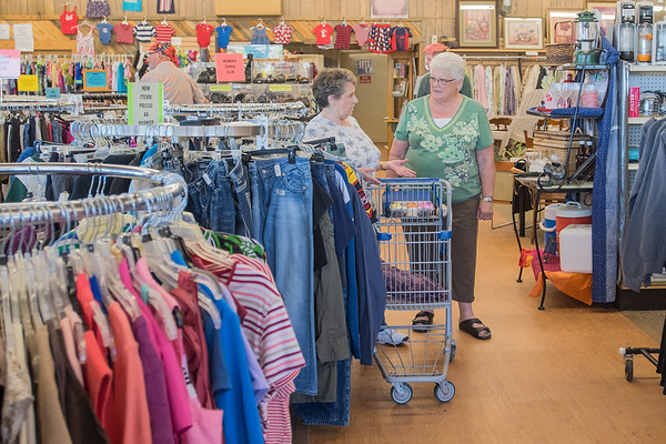 Kathy Hauser (right) talks with Joann Frank at the Neighborhood Thrift Store in North Mankato. Hoosier has been volunteering at the store for eight years. Photo by Jackson Forderer