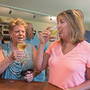 Georgia Boerboom (left) and Connie Wenzel (right) taste the La Crescent wine at Javens Family Winery. Owner Heather Javens said their best-selling wine is New Traditions which is a blend, but her favorite is Marquette, a red wine. Photo by Jackson Forderer