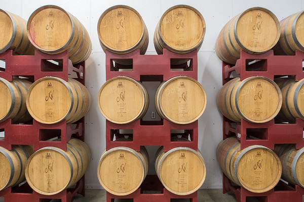 Barrels of wine in storage at Javens Family Winery in rural Mankato. Parts of the barrels include wood from Minnesota. The winery has roughly two and a half acres of vineyards and it also purchases grapes from other vineyards to make their wines. Photo by Jackson Forderer