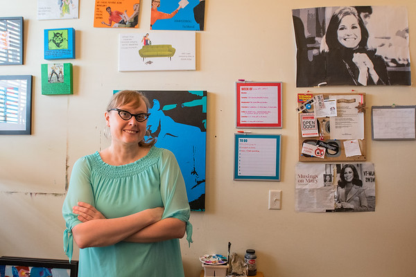Amanda Wirig, marketing and program coordinator for Twin Rivers Arts Council, in her office. Wirig has worked for TRAC for four and a half years and creates her own art from painting and mixed media as well. Photo by Jackson Forderer