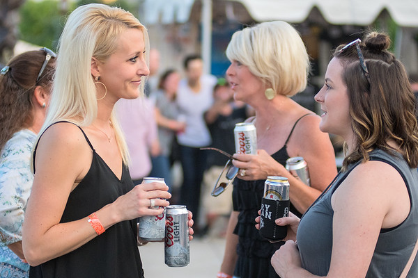 From left, Haley Deike, Karen Wasko and Kenzie Pomranke talk and drink before the start of the Gary Allan concert held at the Vetter Stone Amphitheater on June 22. Photo by Jackson Forderer