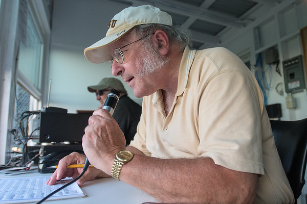Bob Reinhart announces a batter at the New Ulm Brewers game against the Gibbon Reds. Reinhart has been announcing games in New Ulm for 35 years. Photo by Jackson Forderer