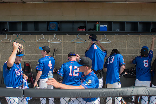 The Mankato National team gathers their belongings and wind down in the dugout after defeating Sleepy Eye at Franklin Rogers Park. Photo by Jackson Forderer
