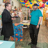 Curt Germundson (right) talks to Kyle Lenzen at the 410 Project as Lenzen came in to pick up his piece of artwork. Germundson works as a volunteer at the 410 Project and has been instrumental in its success as an arts organization. Photo by Jackson Forderer