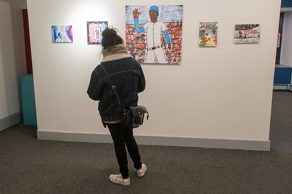 The author checks out a solo exhibition by Jeremy Redlien at the 410 Project. Photo by Jackson Forderer