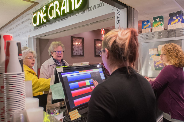 Lauriann Cecil (center) help Lynne and John Seitzer pick out their seats for a movie and Emma Langemo (right) awaits any concessions order the two may have at the Cine Grand 4 movie theater in downtown Mankato. Photo by Jackson Forderer