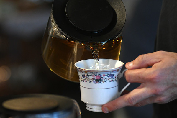 Aaron Sorensen pours himself some tea at Curiosi-Tea House while the tea house offered five different teas for $5.