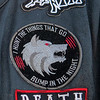 Patches on Mr. Wolf's jacket.