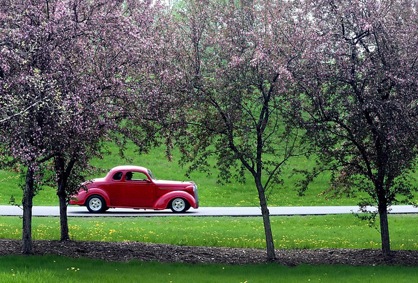 Pat Christman<br /> A street rod rolls through Land of Memories Park during the Minnesota Street Rod Association's gathering Saturday in Mankato.