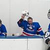 ??? puts his goalie helmet back on during a brief intermission between periods. Photo by Jackson Forderer