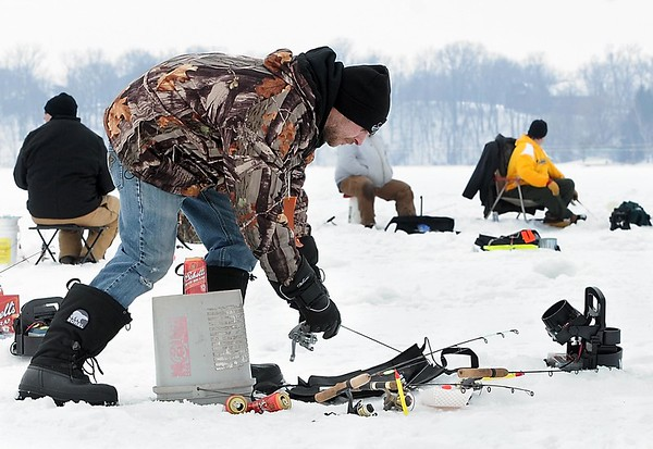 Sam Bode, of New Ulm, jigs as he watches a fish on a fish finder during the Big Bobber Ice Fishing Tournament Saturday on Lake Washington.