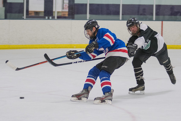??? keeps the puck away from an opposing player. Photo by Jackson Forderer