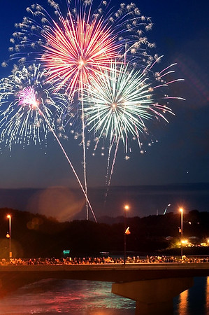 John Cross<br /> Fireworks from Riverfront Park light up the sky over the crowded Veterans Memorial Bridge Monday.