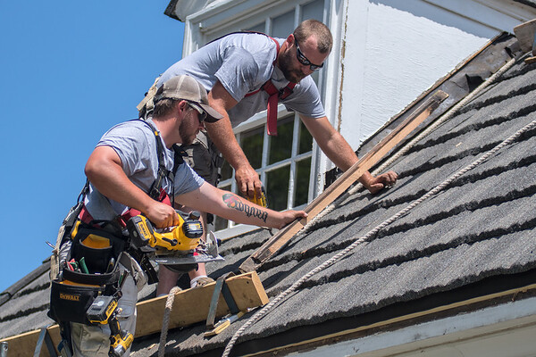 Tyler Theis (left) and Ryan Mattes of Schmidt Siding and Window work on a roof in Mankato. Schmidt Siding and Window won three different categories, best roofing, siding and windows. Photo by Jackson Forderer