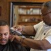 Richmond Clark (right) gives a haircut to Marcellus Butler at Y Barbers in North Mankato. Photo by Jackson Forderer
