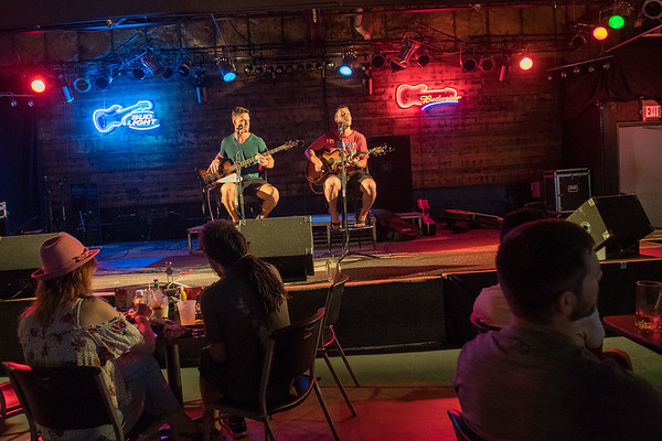 Vaughn Leuzinger (right) and Josh Leuzinger play on stage at Buster's during an acoustic showcase that is held the second Friday of every month. Photo by Jackson Forderer