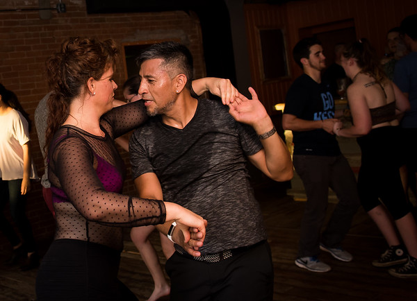 Salsa instructors Jessica Roemhildt (left) and Darío Alvarez perform a turn during the open dance session of their salsa class, which meets at Midtown Tavern. Photo by Casey Ek