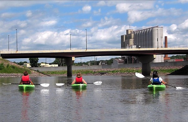 Pat Christman <br /> From left, Donna Kreykes and her daughters Stacie Afflerbaugh and Jessica Braaten float down the Minnesota River near downtown Mankato during Paddle Jam Saturday.