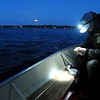 Pat Christman<br /> Ryan Scholl baits his hook during the early morning hours of Minnesota's walleye fishing opener Saturday on Lake Washington.