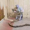 Matt Mader of Mader Insulation spray foam insulates an apartment in North Mankato. Mader said he has been in the insulation business for five years. Photo by Jackson Forderer