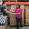 Deisy De Leon Esqueda, manager at the ECHO Food Shelf since 2003, helps volunteer Francisco Esquivel stack a pallet of juice at the store in September. Photo by Jackson Forderer