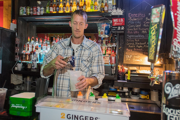 Travis Wachtel, a bartender at the What's Up? Lounge, makes a drink during the Ian Hilmer Band and Tony Flynn Project concert in September. Photo by Jackson Forderer