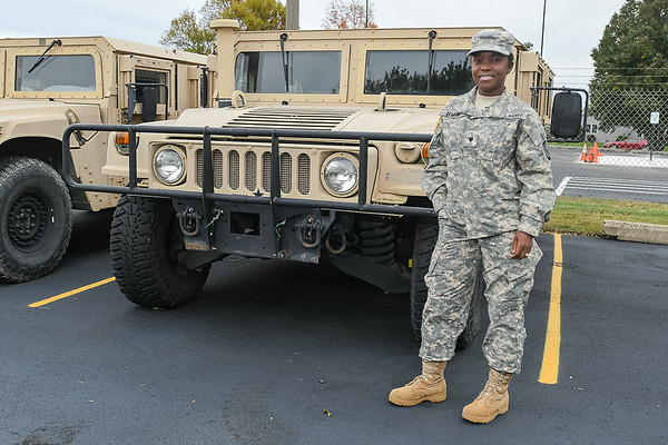 "Freda Steffl, originally from Nigeria, joined the Army and is still in the Army Reserve. She is pictured here in front of a humvee at the Mankato Armory. Steffl said one of the reasons she joined the Army was because of its rigorous physical training. ""I'm so obsessed with being strong,"" she added. Photo by Jackson Forderer"