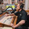 Justin Fasnacht runs the sound board during the KMSU radio show Minnesota Music Connection. Fasnacht also owns and runs FuzzTalkRadio, a 24/7 Internet radio station. Photo by Jackson Forderer