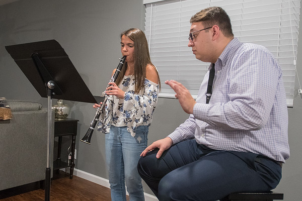 Maddie Ceminsky (left), 15, practices playing clarinet with instruction from her teacher Hunter Ellis who has been teaching clarinet for eight years. Photo by Jackson Forderer