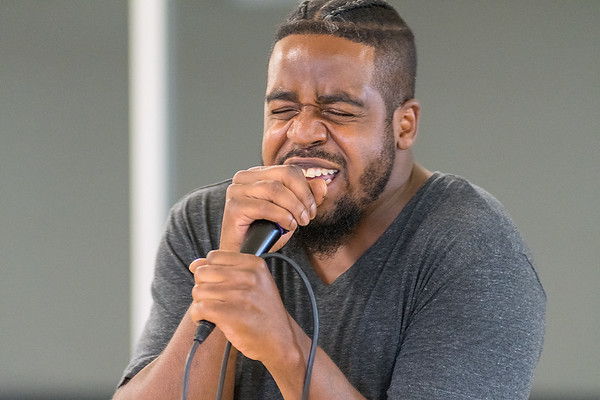 Trent Walton, who goes by Lumanati the God, performs spoken word at Revival Sessions 2 held at the Caledonia Community Center. Photo by Jackson Forderer