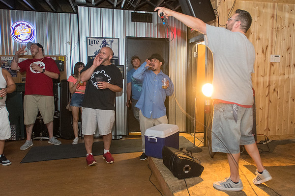 Nathan George (right), who goes by the stage name Ill Poe, does a call and response with the audience at Midtown Tavern during Just Smoke Day held on Sept. 1. George said that he has been rapping for 20 years. Photo by Jackson Forderer