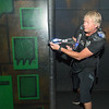 Chris Oftedahl looks out from his cover position while playing laser tag with family and friends at the Wow! Zone. Photo by Jackson Forderer