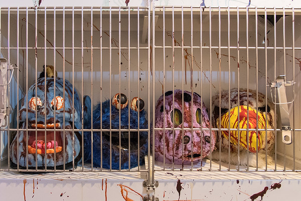 Bloody mascot masks in a cage in one of the rooms in the phobia building of Northern Frights.