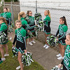 Waterville-Elysian-Morristown cheerleaders hang out on the sidelines before the start of a football game in Waterville.