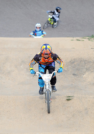 Pat Christman <br /> Adam Welter rides during a race at the BMX track.