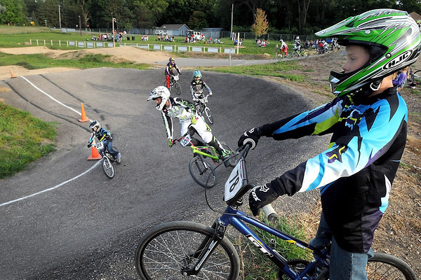 Pat Christman <br /> Nick Koshenina watches a race from atop one of the turns at the Mankato BMX track.
