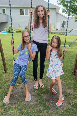 The Schwertfeger girls on their swing set. From left, Grace, 12, Autumn, 14, and Fatih, 8. Grace was born 16 weeks prematurely. The Schwertfeger family was chosen to be this year's March of Dimes ambassadors. Photo by Jackson Forderer