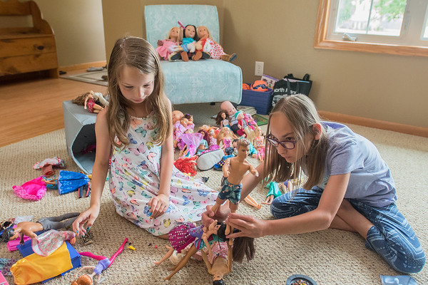 Grace Schwertfeger (right), 12, and her sister Faith, 8, play with their dolls at their house in Mankato. Grace was born 16 weeks prematurely and still has problems with her eyesight. Photo by Jackson Forderer