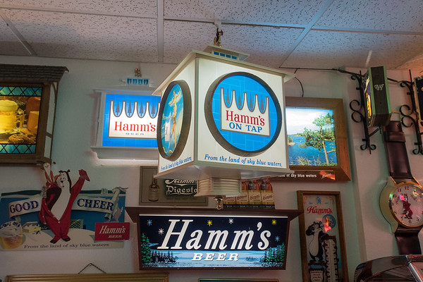 Signs in Steve Miner's Hamm's Beer collection in his basement. Photo by Jackson Forderer