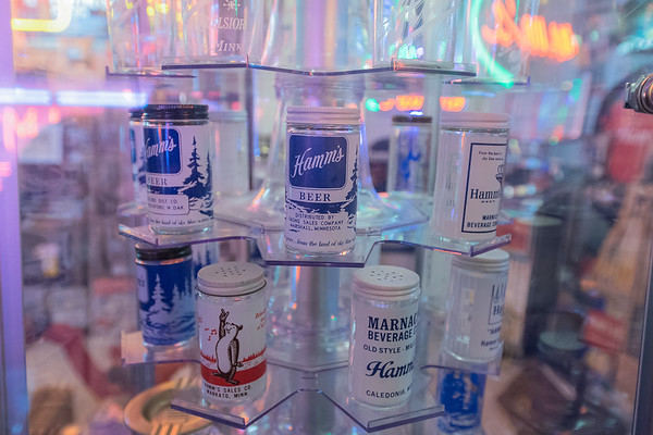 A collection of salt and pepper shakers, each one different and each one bearing a Hamm's Beer logo on it, in Steve Miner's basement. Photo by Jackson Forderer