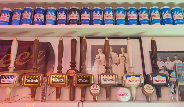 Beer cans and tap handles in Steve Miner's Hamm's Beer collection in his basement. Photo by Jackson Forderer