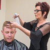 Tami Tupy sprays Ben Yokiel's hair while giving him a haircut at Liv Aveda Salon and Spa. The salon offers hair cutting, coloring, spa services, massages, waxing, facials, body wraps and spray tanning. Tupy opened the salon 16 years ago. Photo by Jackson Forderer
