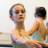 Marblehead native Emma Grazado, 12, warms up during rehearsal. Grazado will be performing in the Boston Ballet's Nutcracker this winter. David Le/Staff Photo