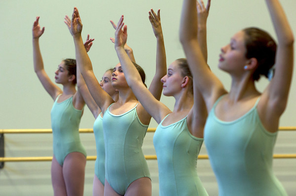 Dancers at the Boston Ballet School in Marblehead at the Lynch/van Otterloo YMCA during class. David Le/Staff Photo